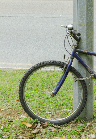 off road biking: Detail of a Mountain Bike Tire in the Background.