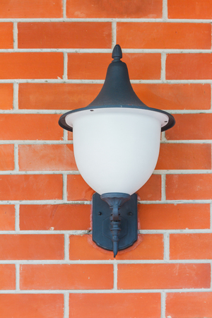 wall lamp: Traditional street lamp on a street in the Old Town background.