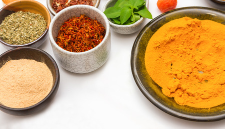 dry food: Spices for heath and cooking on white background.