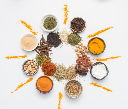 indian food: Spices for heath and cooking on white background.