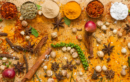 indian cooking: Spices for herb and cooking on brown background. Stock Photo