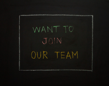 want: WANT TO JOIN OUR TEAM?  on black background. Stock Photo