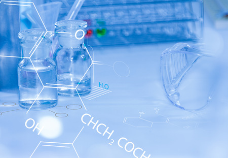 medical lighting: Laboratory glassware containing chemical liquid, science research.