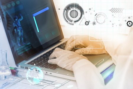 lighting technician: scientist working on computer for analysis. Stock Photo