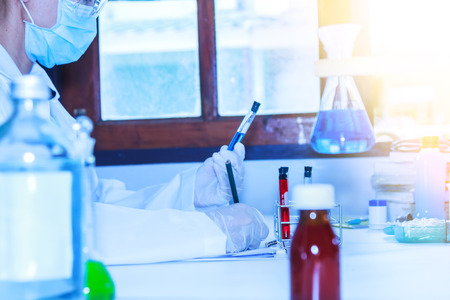 medical lighting: Scientist with laboratory fucus at pencil background and concept.