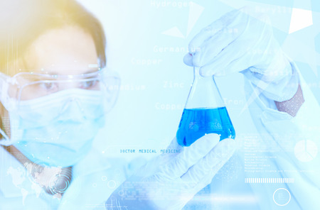 lighting technician: Scientist with laboratory background and concept. Stock Photo