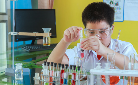 Boy doing science experiment, science Education and selective focus.