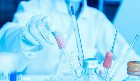 lighting technician: Scientist with equipment laboratory for science concept. Stock Photo