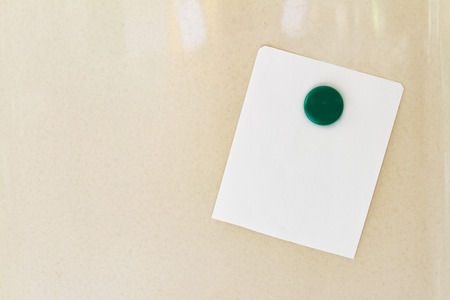 forgetful: Empty paper sheet on refrigerator door.