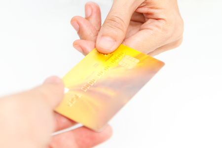 bankcard: Online payment, hands holding a credit card and using for online shopping,shoping card,shoping content.