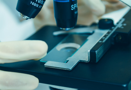microscope slide: Medical equipment. microscope,in a laboratory microscope with microscope slide,science concept,science education and selective focus.