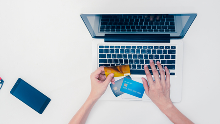 bankcard: The online shopping card and holding credit card with hand for payment online shopping, this lifestyle new generation of people on the world for decoratedesign business content or finance content.
