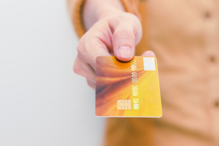 bankcard: Beautiful woman showing credit card for online payment, hands holding a credit card and using for online shopping,shopping card,shopping content.