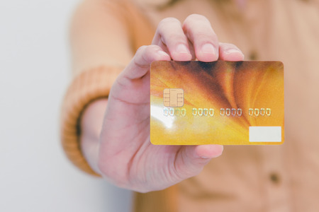 Beautiful woman showing credit card for online payment, hands holding a credit card and using for online shopping,shopping card,shopping content.