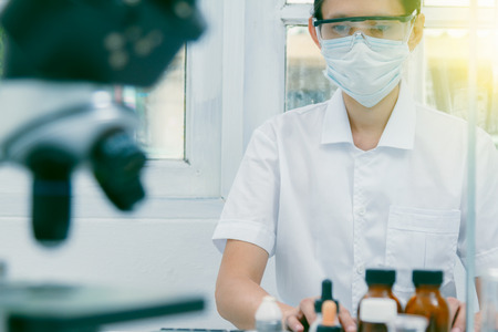 The scientist test in lab or science research,science concept.Scientist work in process at laboratory,Science experiments and selective focus,Science laboratory test tubes.