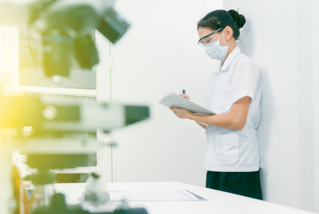 (SCIENCE) Scientist are certain activities on experimental science like mixing chemicals, microscope, entry data to develop science medicine or food for everyone on the world and selective focus.