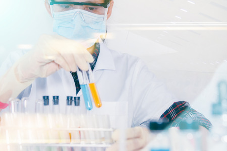 certain: (SCIENCE) Scientist is certain activities on experimental science like mixing chemicals, microscope, entry data to develop science medicine or food for everyone on the world, Film effect. Stock Photo