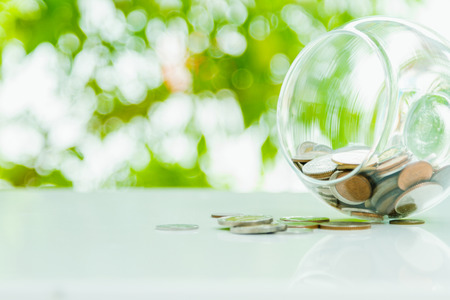 Coins in a glass,finance concept,business background,money content and selective focus. Stock Photo