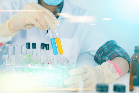 (SCIENCE) Scientist is certain activities on experimental science like mixing chemicals, microscope, entry data to develop science medicine or food for everyone on the world, Film effect. Stock Photo