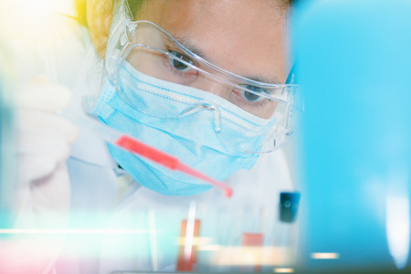 certain: (SCIENCE) Scientists are certain activities on experimental science like mixing chemicals, microscope, entry data to develop science medicine or food for everyone on the world, Film effect.