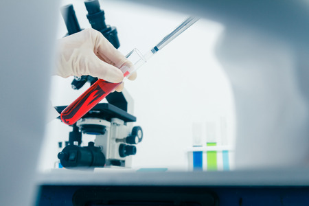 (SCIENCE) Scientists are certain activities on experimental science like mixing chemicals, microscope, entry data to develop science medicine or food for everyone on the world, science background.