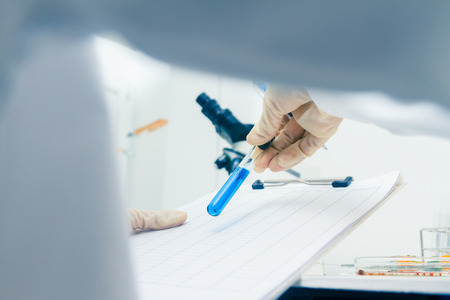 (SCIENCE) Scientist is certain activities on experimental science like mixing chemicals, microscope, entry data to develop science medicine or food for everyone on the world, science background. Stock Photo