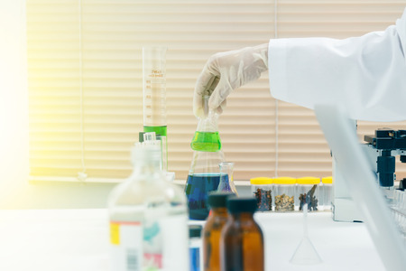 certain: (SCIENCE) Scientists are certain activities on experimental science like mixing chemicals, microscope, entry data to develop science medicine or food for everyone on the world, science background.