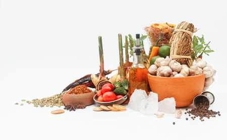 peppery: Indian spices in terracotta pots on white background, top view mix indian spices and herbs difference ware on white background with copy space for design vegetables, spices, herbs or foods content Stock Photo