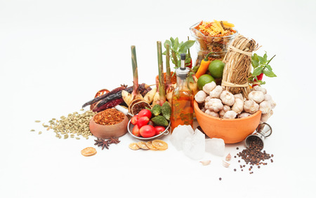 peppery: Group of indian spices and herbs on white background, normal view mix indian spices and herbs difference ware on white background with copy space for design vegetables, spices, herbs or foods content.