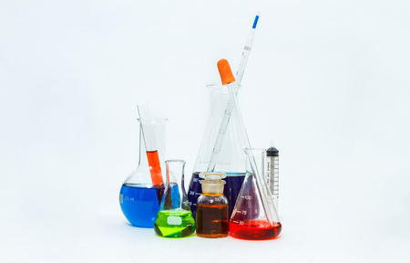 science laboratory glassware,Group of laboratory flasks empty or filled with a clear liquid on blue tint scientific graphics background and their reflection on a table,science background,science glassware and selective focus.