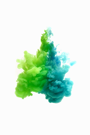 Colors dropped into liquid and photographed while in motion. Ink swirling in water. Cloud of silky ink in water isolated on white background. Colorful ink in water, an abstract banner. Imagens - 69848064