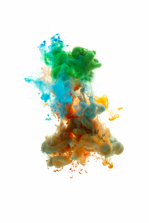 Colors dropped into liquid and photographed while in motion. Ink shape or swirling in water for design or decorate background or abstract banner with clipping paht on white background.