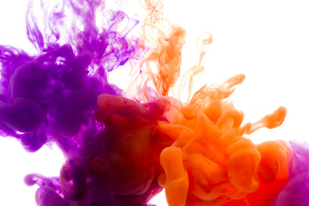 Colors dropped into liquid and photographed while in motion. Ink shape or swirling in water for design or decorate background or abstract banner with clipping paht on white background. Stock Photo