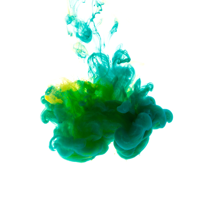 drops of water: Colors dropped into liquid and photographed while in motion. Cloud of silky ink in water on white isolated background, an abstract banner. Stock Photo