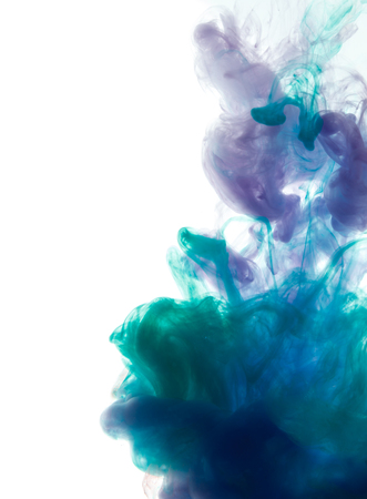 Colors dropped into liquid and photographed while in motion. Cloud of silky ink in water on white isolated background, an abstract banner. Imagens - 89287363
