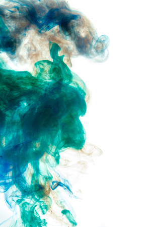 Colors dropped into liquid and photographed while in motion. Cloud of silky ink in water on white isolated background, an abstract banner. Imagens - 89287483