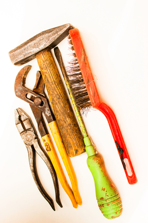 Old rusty tools must be replaced with new ones. Stock Photo