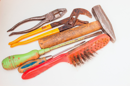 replaced: Old rusty tools must be replaced with new ones. Stock Photo