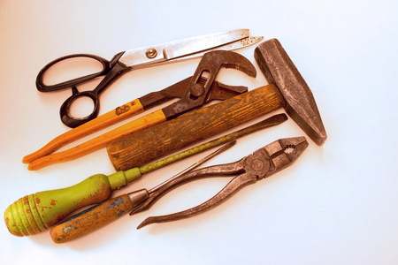 yourself: Old rusty tools must be replaced with new ones. Stock Photo