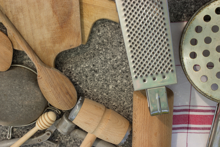 pin board: Rural kitchen utensils on vintage planked wood table from above - rustic background with free text space Free space in the shape of a heart. Stock Photo