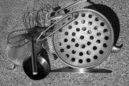 pin board: Rural kitchen strainers on a table from above