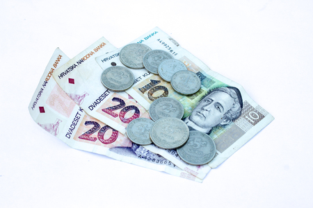 Croatian coins on the various Croatian banknotes money like background.