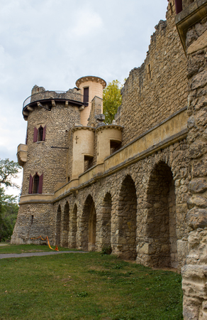 Jans castle - arches in castle walls. There is a green lawn around the castle. Editorial