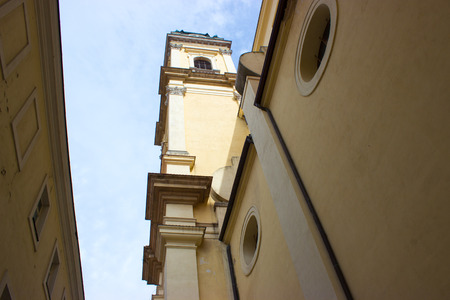gods: View of the church. On the background is a blue sky with white clouds. Stock Photo