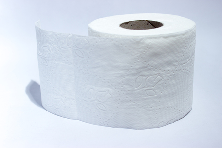 white sheet: Toilet paper isolated over a grey background