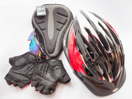 Bicycling helmet glasses gloves gel seat and computer on the grey background Stock Photo