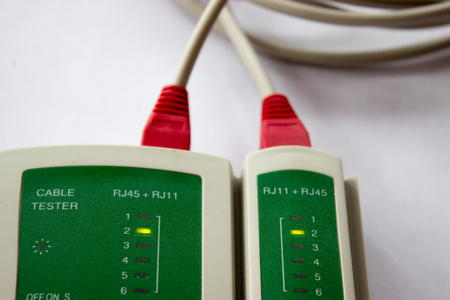 Network LAN cable tester on the white background. Networking tool. Stock Photo