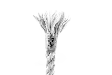 The end of the rope with the face on the white background with free space for text.