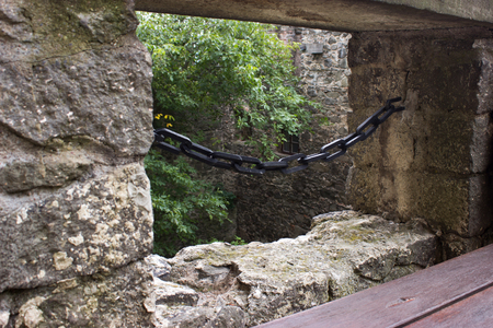 View over the loophole protected chain in the castle. In the foreground is a wooden bench. Stock Photo