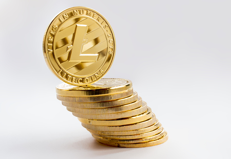 On a gray background are gold coins of a digital crypto  currency - litecoins.